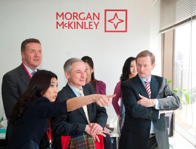 An Taoiseach Enda Kenny and Minister Richard Bruton at the offices of Morgan McKinley in Shanghai with Group Chief Executive Officer Pat Fitzgerald and Vivian Ng, Managing Director, Morgan McKinley, China.