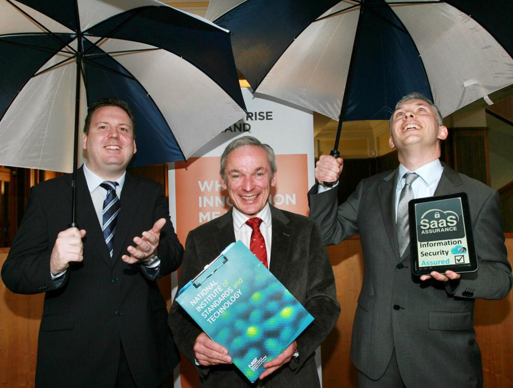 Minister for Jobs, Enterprise and Innovation, Richard Bruton TD with Mark Dunne and Peter Van den Bossche of 2SAAS